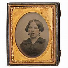 [EARLY PHOTOGRAPHY] Tinted double-sided sixth-plate ambrotype in a hinged leather case with clasps, with two bust length por...
