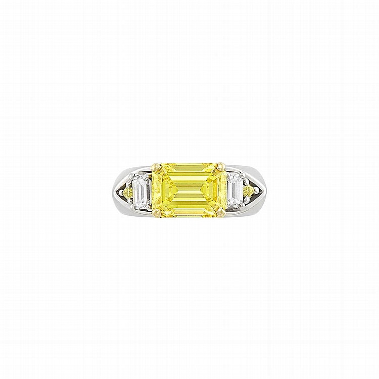 Platinum, Fancy Vivid Yellow Diamond and Diamond Ring