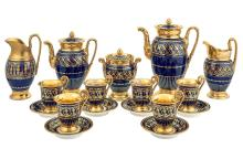 Paris Porcelain Cobalt Blue-Ground and Gilt-Decorated Part Coffee and Tea Service; Together with an Associated Milk Jug