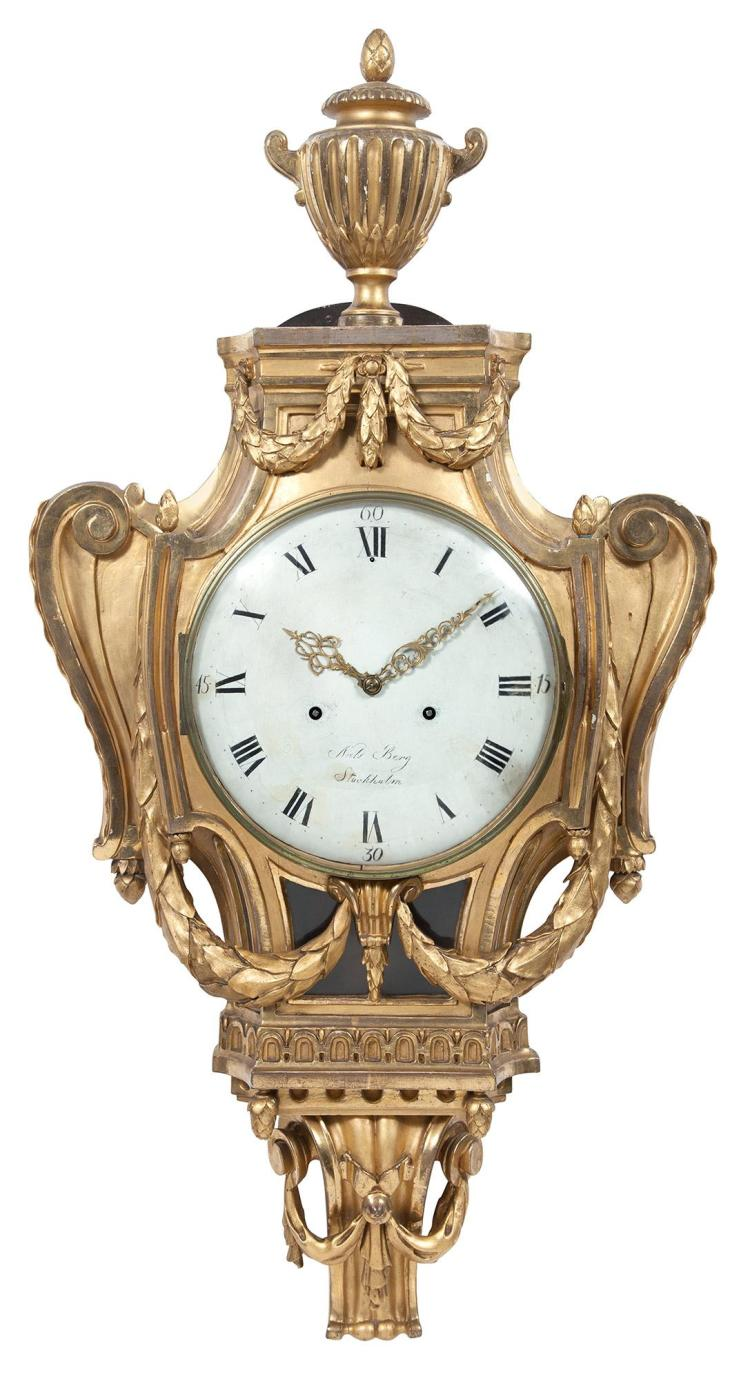 Swedish Neoclassical Giltwood Cartel Clock The white-painted dial signed Niels [sic] Berg / Stockholm, with two-train move...