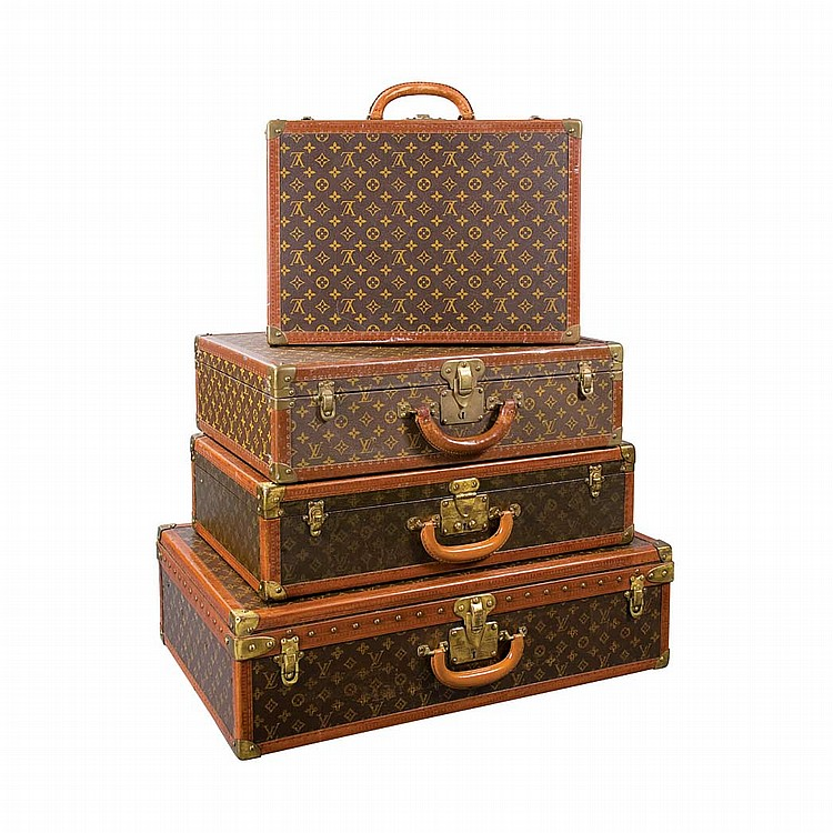 Group of Four Louis Vuitton Suitcases