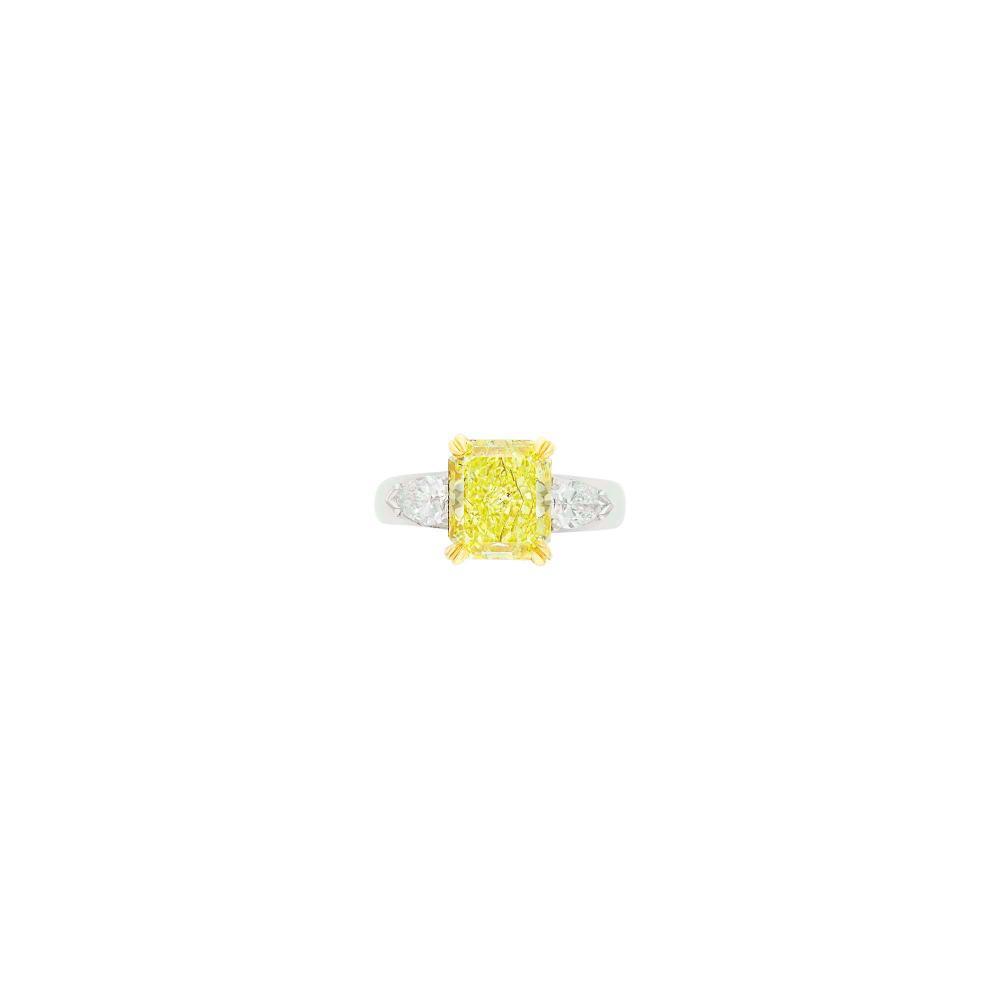Platinum, Gold, Fancy Intense Yellow Diamond and Diamond Ring