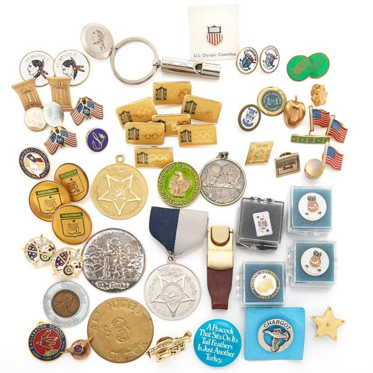 Three Gold-Plated Metal Badges