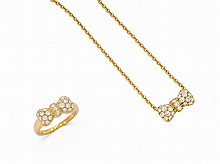 A Set of Diamond and Gold Bow Jewels, Van Cleef & Arpels