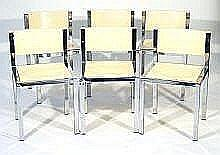 Frank Wardle 1960s chrome framed dining table with smoked glass top, together with six chrome framed chairs with cream plastic seats and backs, the