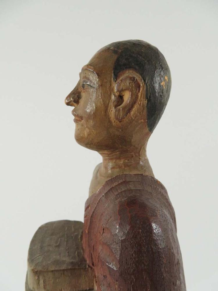 Ancient egyptian carved wooden figure