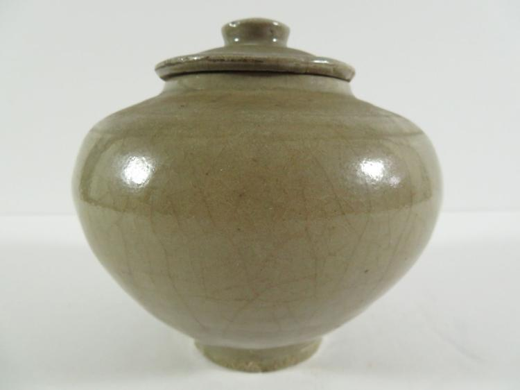 Chinese early celadon covered jar for Asian antiques west palm beach