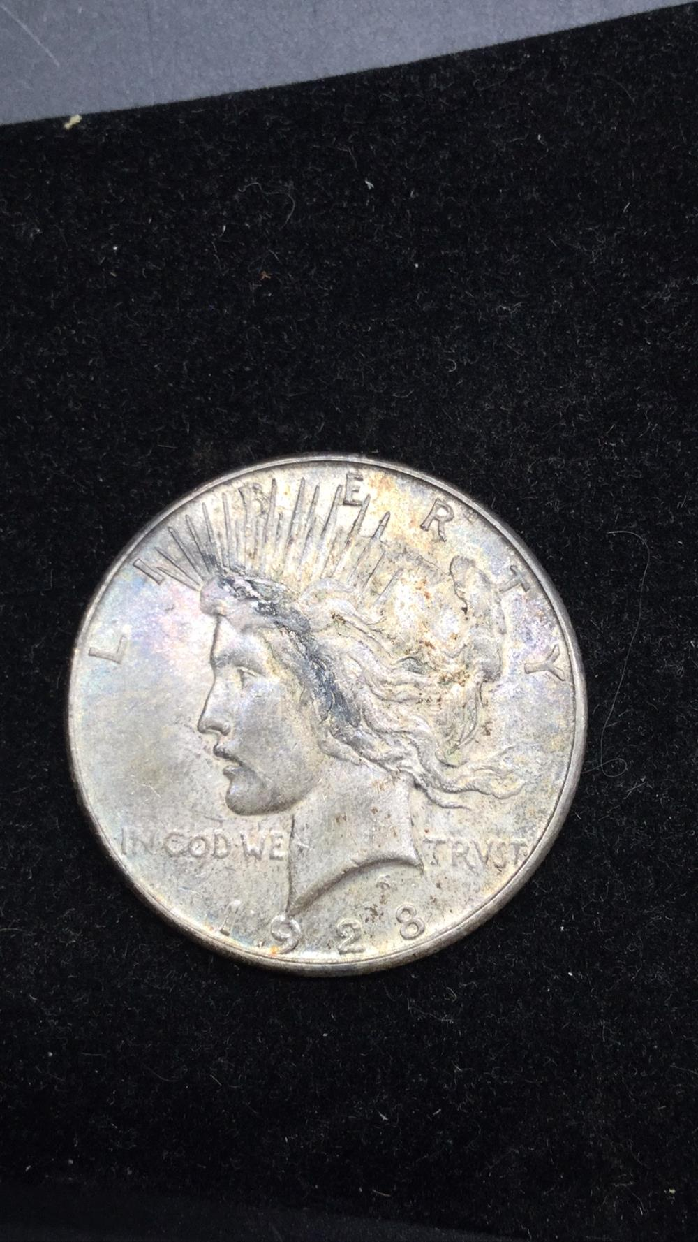Lot 23: 1928 s Peace Dollar