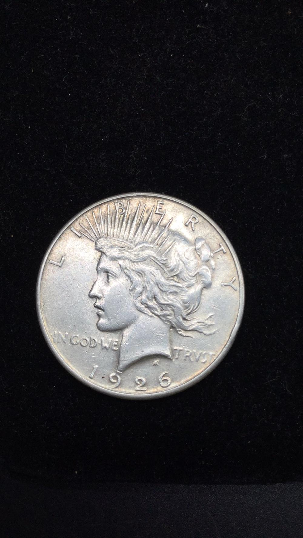 Lot 82: 1926s peace Dollar