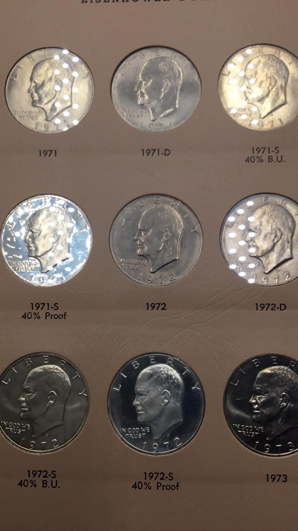 Lot 86: Nine Eisenhower dollars