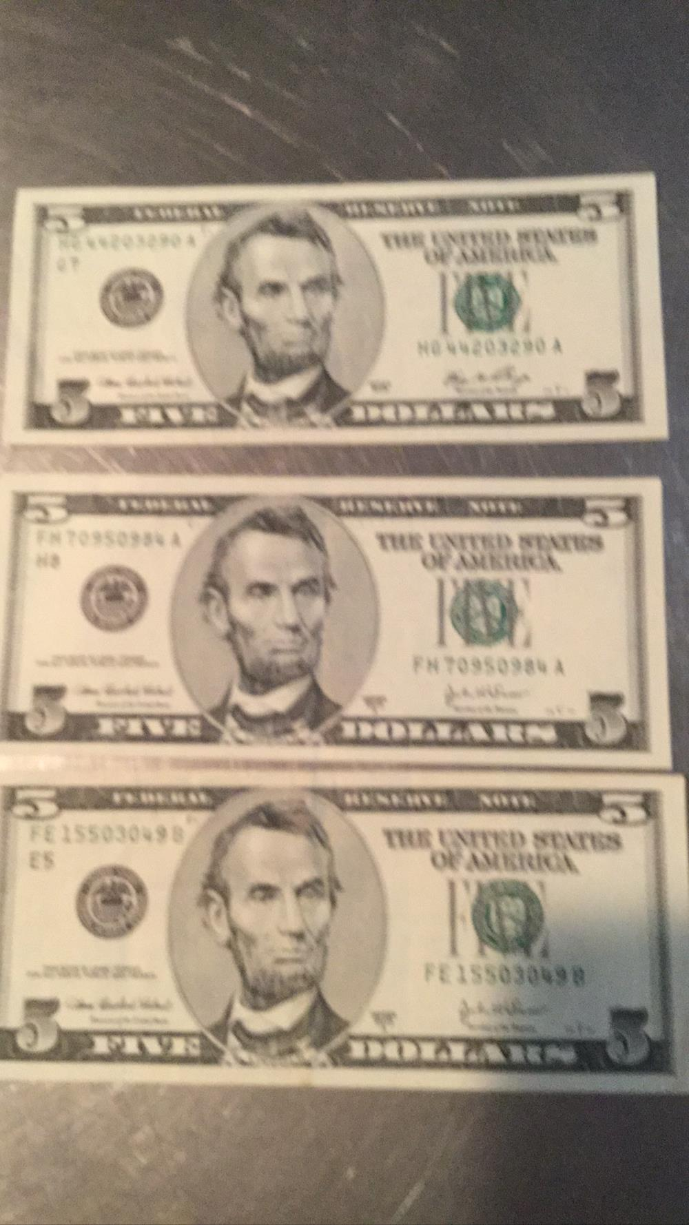 Three 5 Dollars Bills