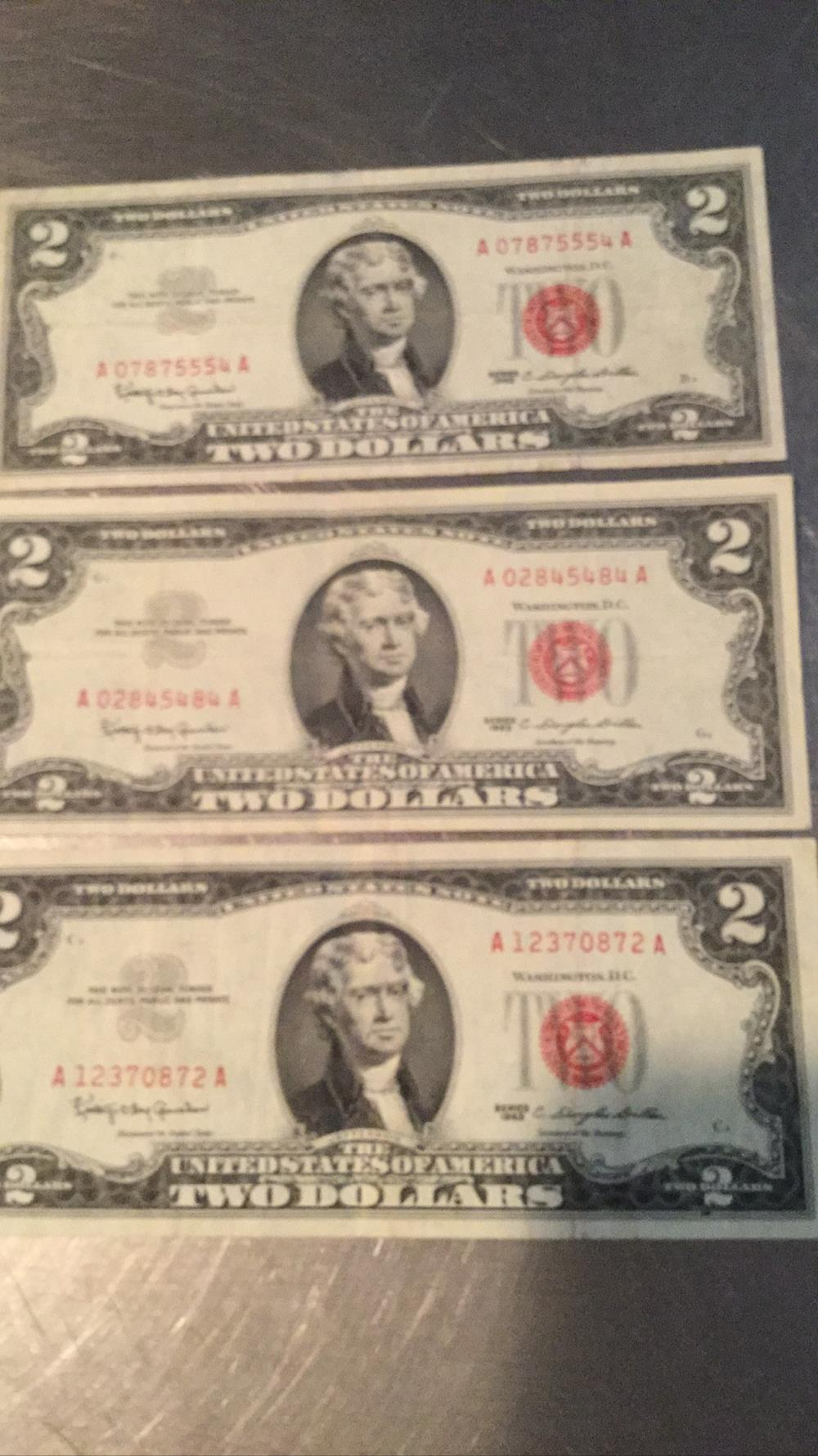 Three 2 dollar bills