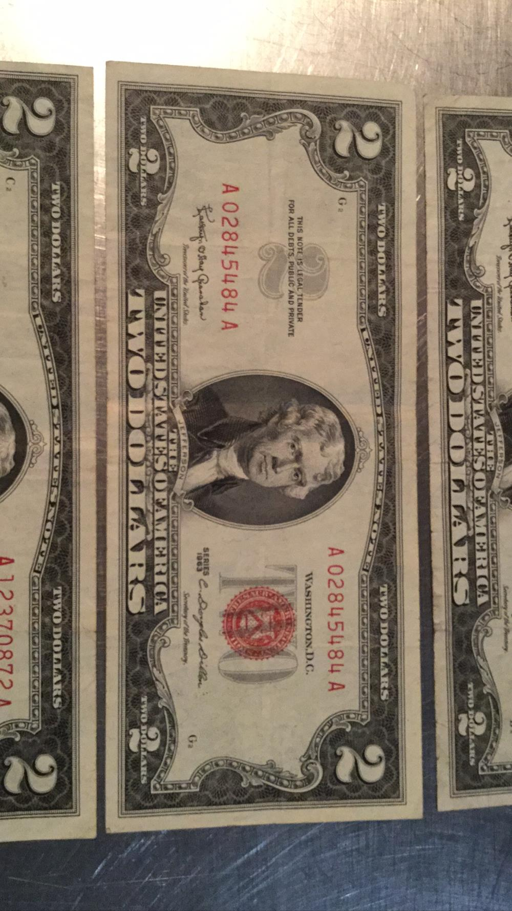 Lot 179: Three 2 dollar bills