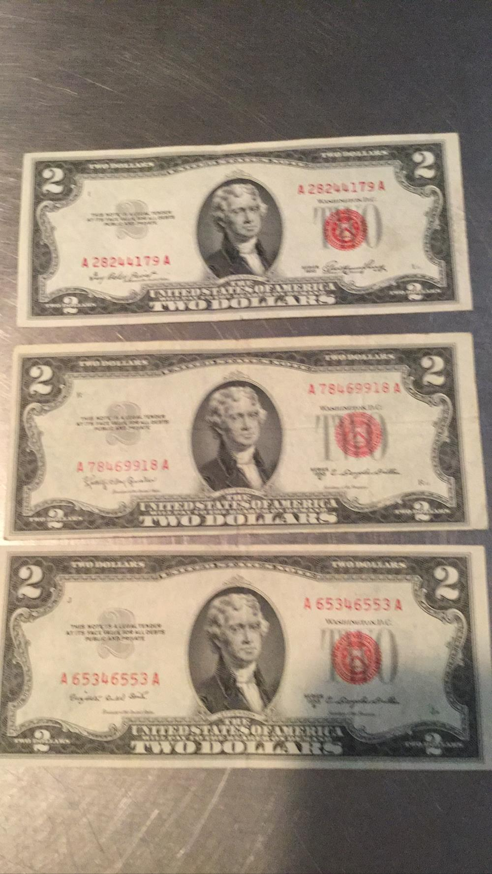 Three $2 dollar bills