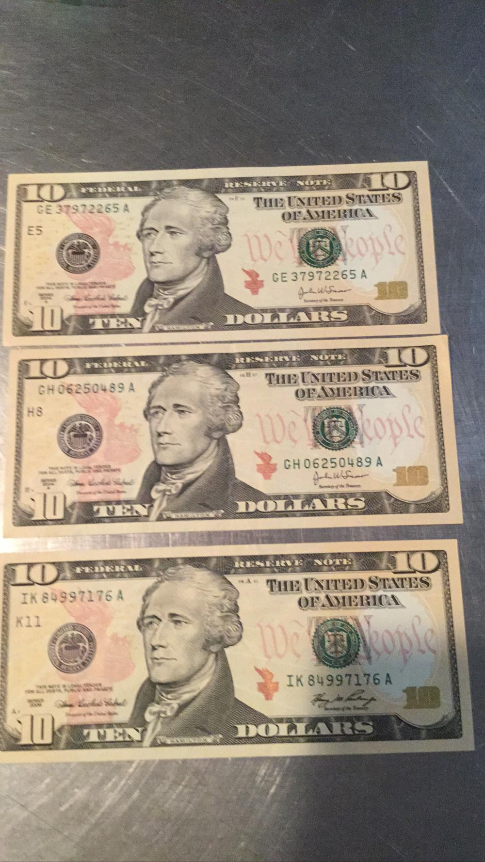Three $10 bills