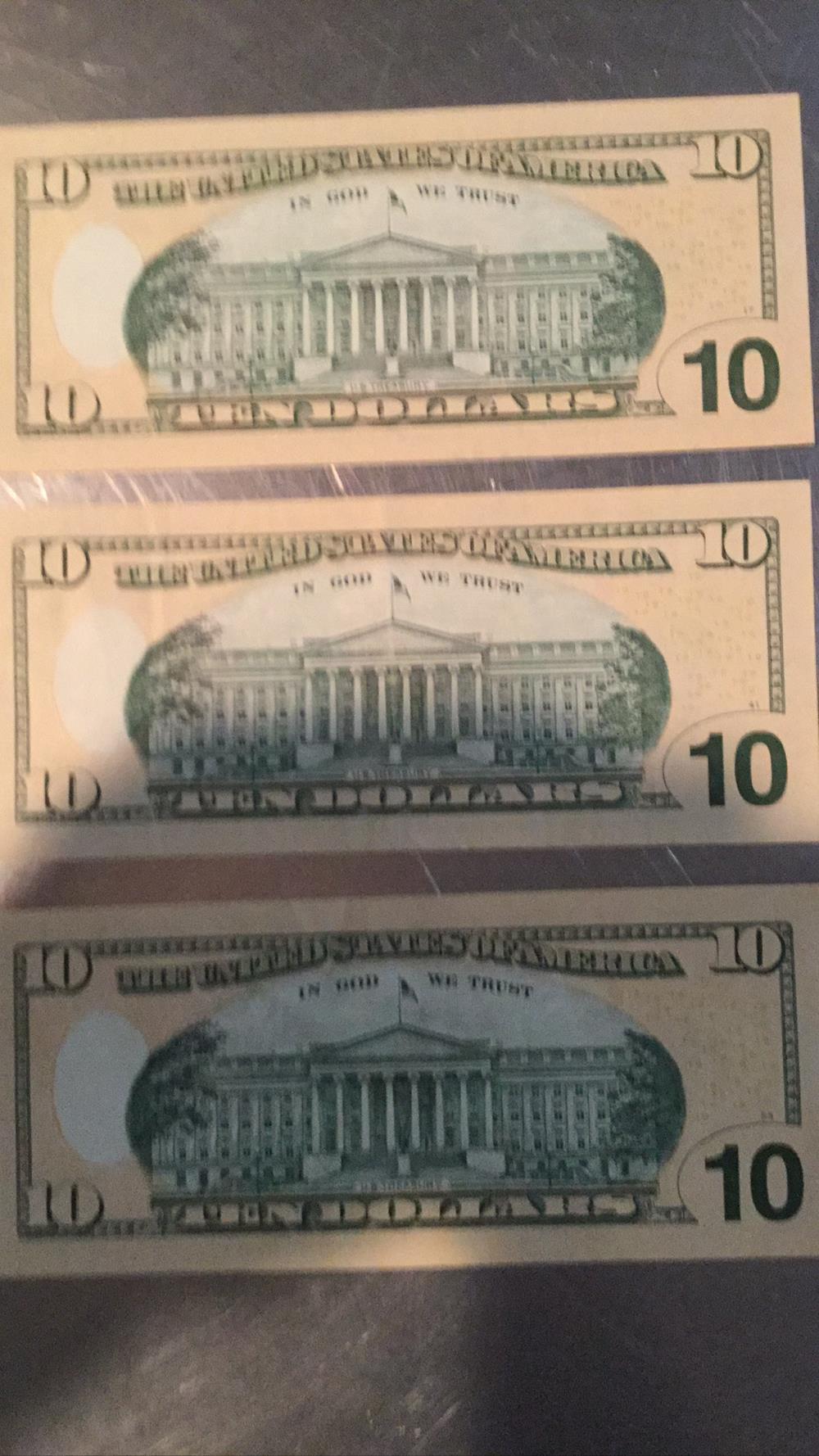 Lot 185: Three $10 bills