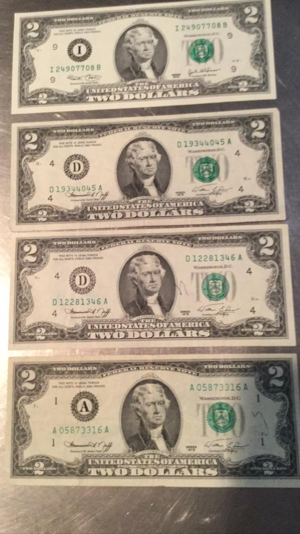 Four $2 dollar bills