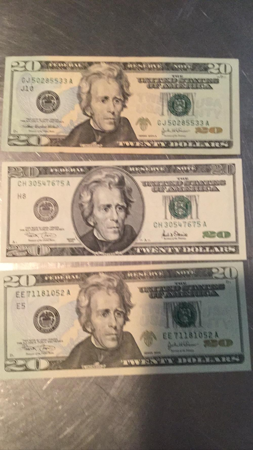 Three $20 bills