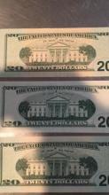 Lot 196: Three $20 bills