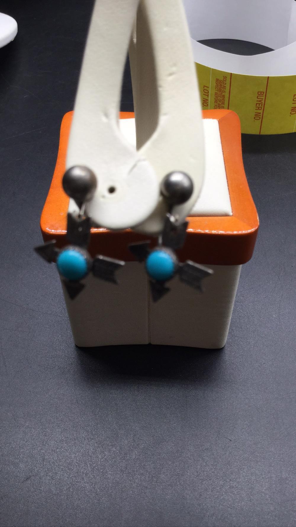 Harvey era earrings