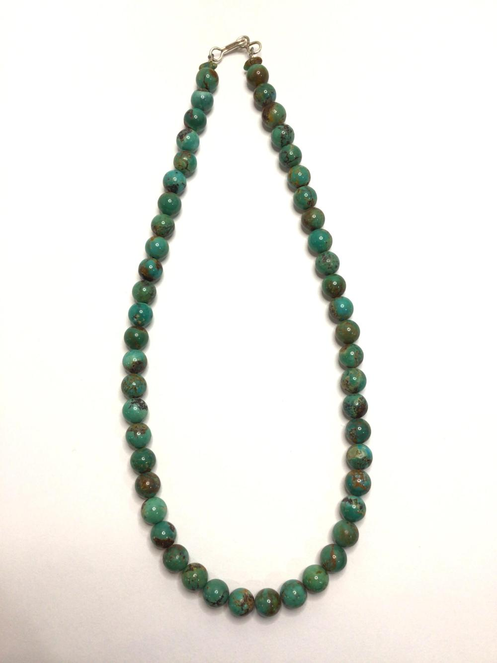 A: Handmade beaded possibly turquoise necklace