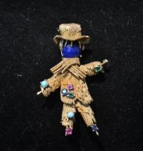 18kt GOLD SCARE CROW PIN WITH EMERALD , SAPPHIRE
