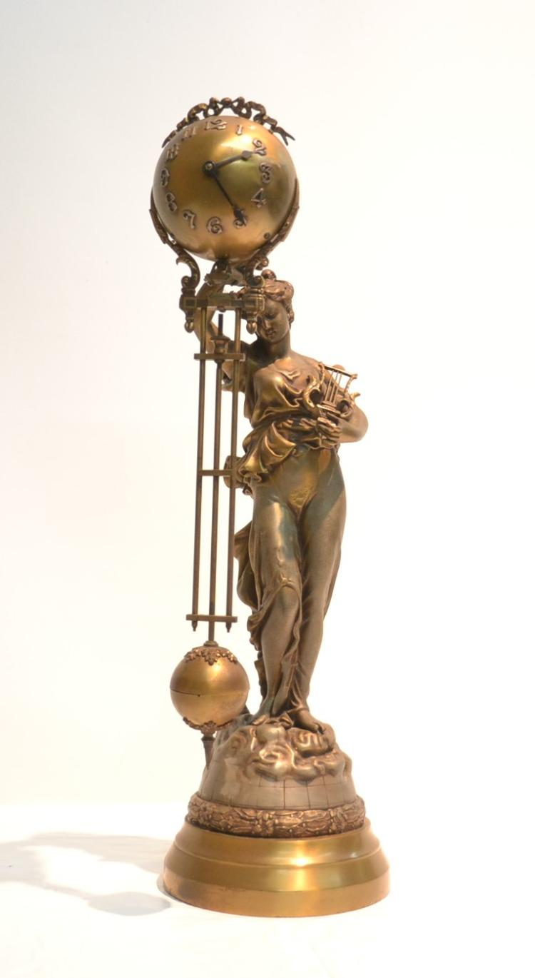 FIGURAL SPELTER SWING ARM CLOCK DEPICTING