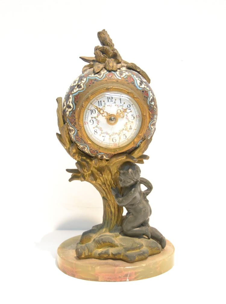 BRONZE CHAMPLEVE KEY WIND CLOCK WITH PUTTI