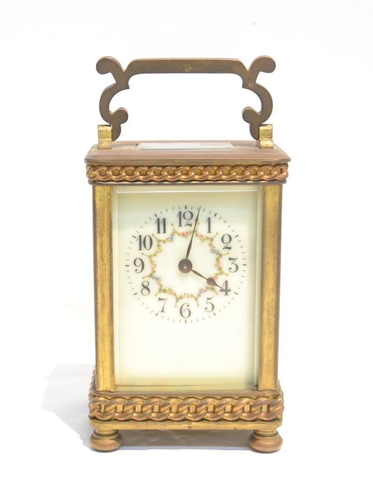 BRONZE CARRIAGE CLOCK WITH CHAIN FORM DECORATIONS