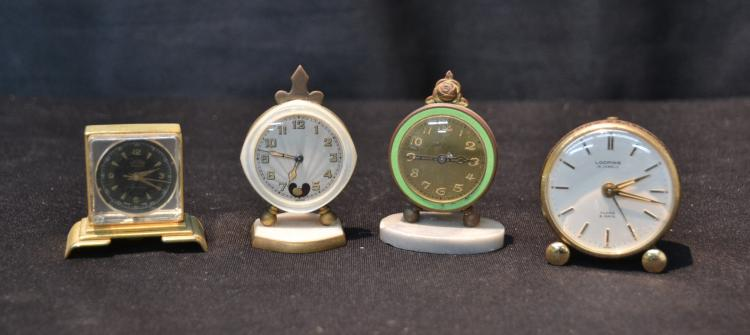 (4) MINIATURE CLOCKS INCLUDING BREVEL , HILTON