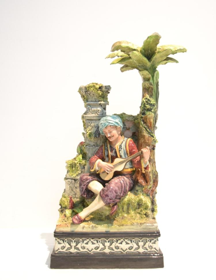 GERMAN MAJOLICA MAN PLAYING MANDOLIN LEANING