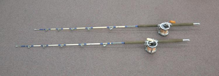 (2) FISHING POLES WITH PENN 9/0 REELS - 82