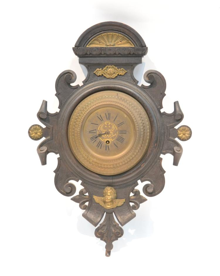 FRENCH BRONZE CLOCK MOUNTED IN WOOD FRAME