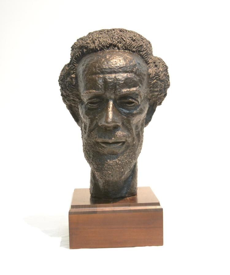PATINATED BRONZE BUST OF MAN WITH BIRD