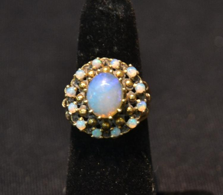 14kt OPAL CENTER STONE RING SURROUNDED BY
