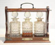 (3) DECANTERS SET IN OAK TANTALUS