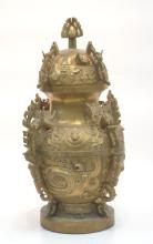 LARGE CARVED BRONZE ORIENTAL COVERED URN