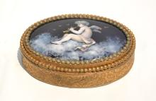 ENAMEL CHERUB WITH HORN SNUFF BOX
