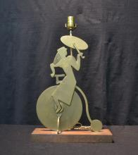 MODERNIST BRONZE GIRL RIDING UNICYCLE LAMP