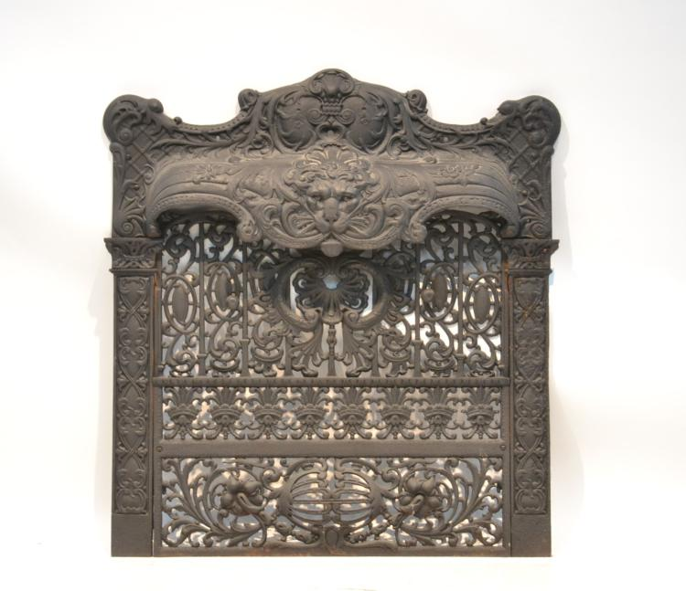 CAST IRON FIREPLACE INSERT WITH LION HEADS
