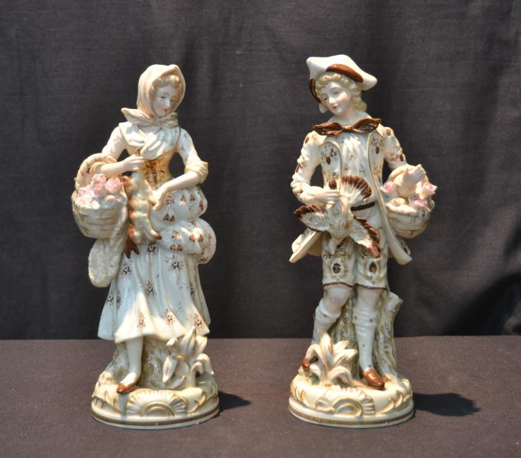 (2) PORCELAIN FIGURINES OF MAN & WOMAN HOLDING