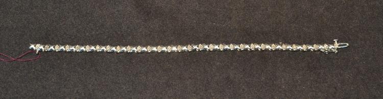 10kt WHITE GOLD DIAMOND XO TENNIS BRACELET