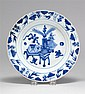 BLUE AND WHITE PORCELAIN PLATE Decorated with scholar's items surrounded by a foliate border. Diameter 8¾