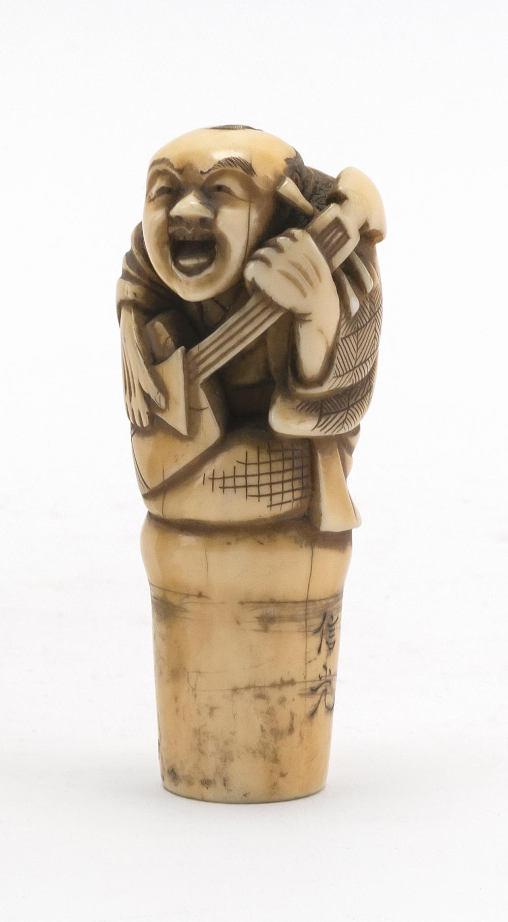 "JAPANESE CARVED IVORY CANE HANDLE In the form of a musician playing a biwa. Signed. Length 3""."