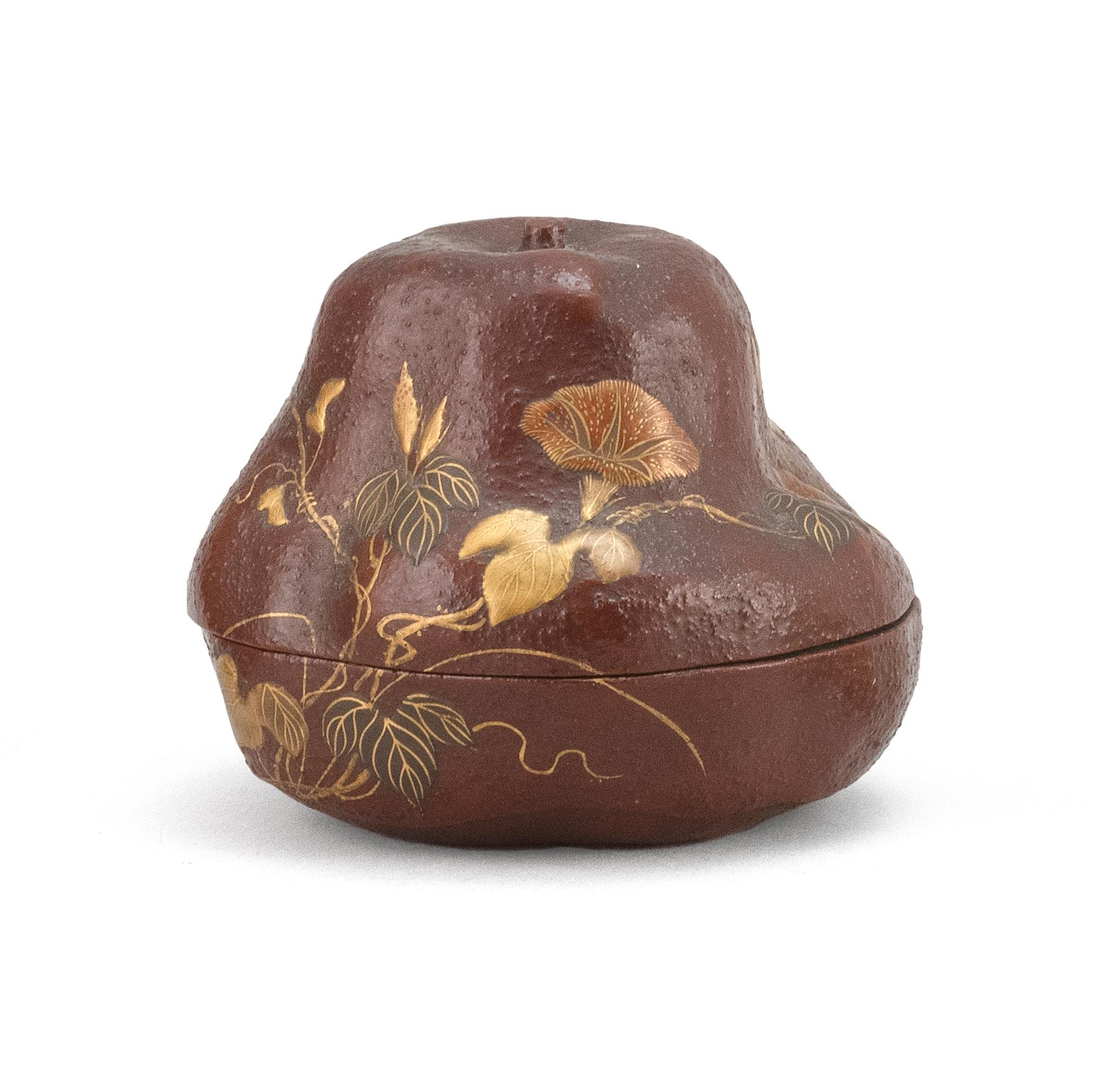 "JAPANESE LACQUER GOURD-FORM NATSUME With a gilt flowering vine on a textured brown ground. Signed. Height 2.5""."