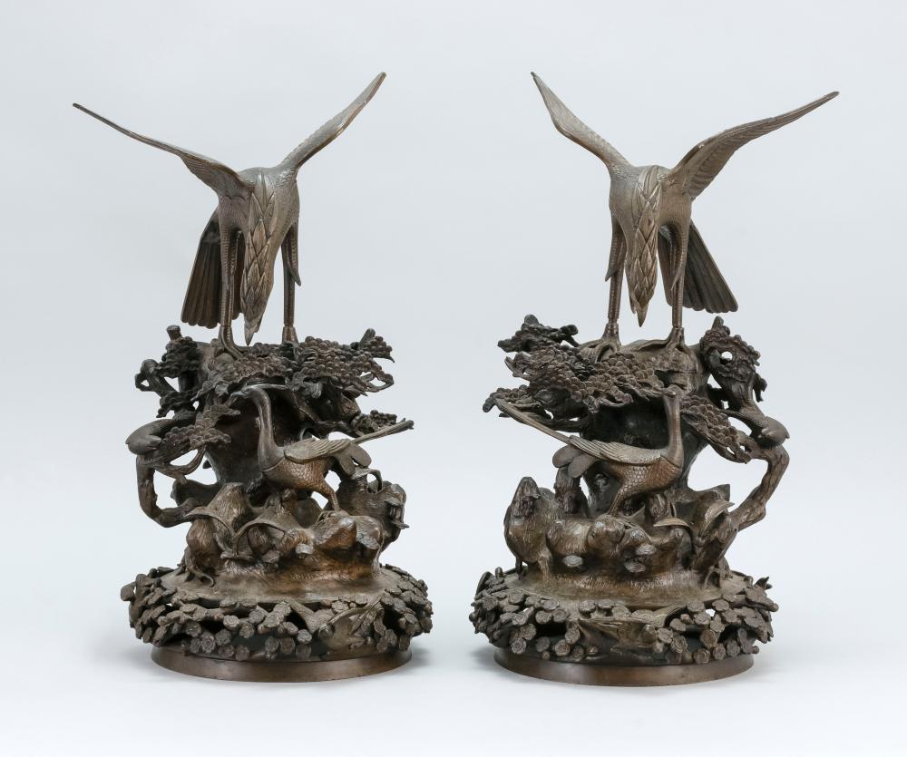 PAIR OF JAPANESE BRONZE SCULPTURES In the form of a pheasant, songbird and eagle in a pine tree, flower and rockery landscape. Heigh...