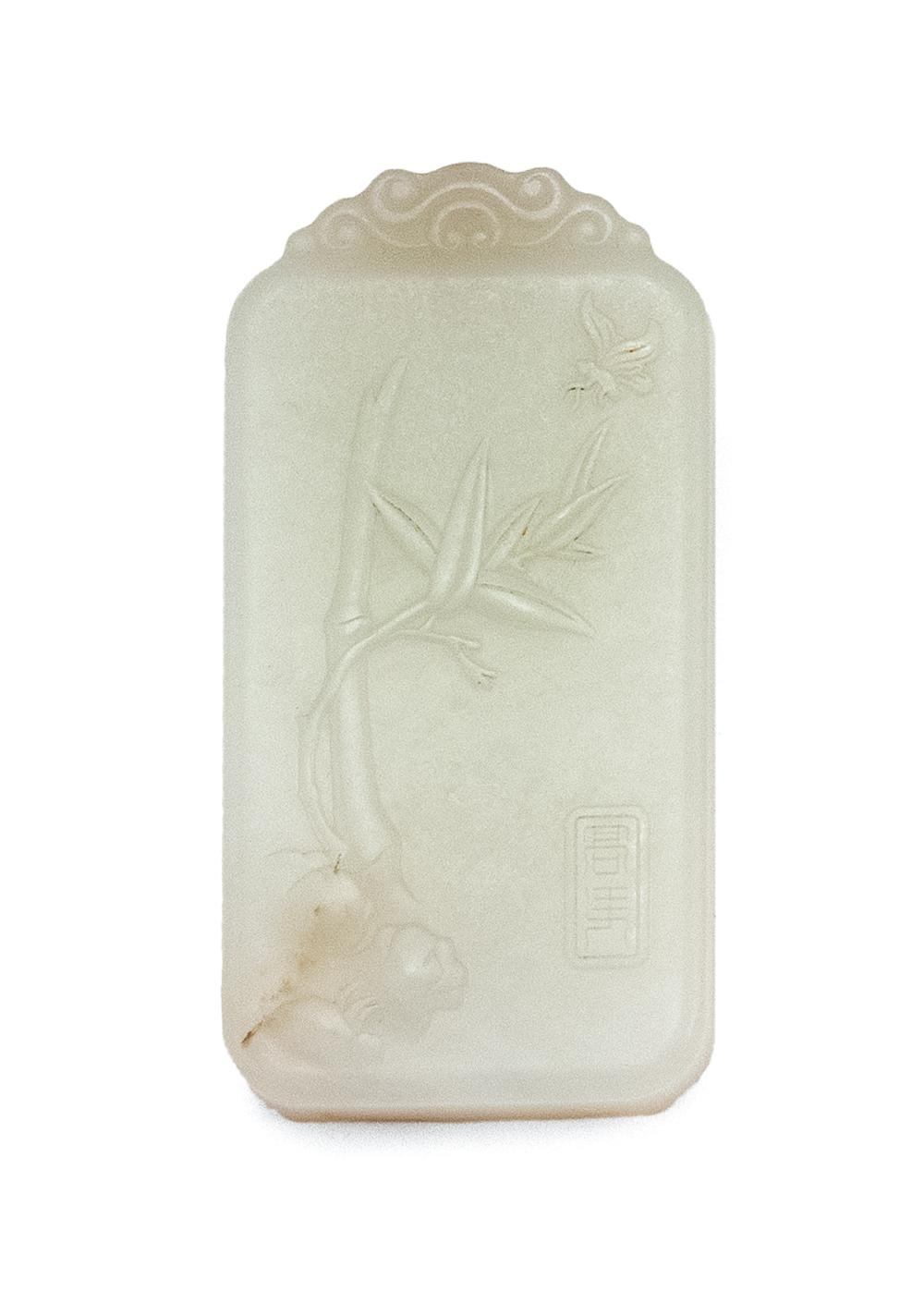 "CHINESE WHITE JADE PLAQUE Rectangular, with bamboo and butterfly carving on obverse and a landscape cartouche on reverse. Length 2.5""."