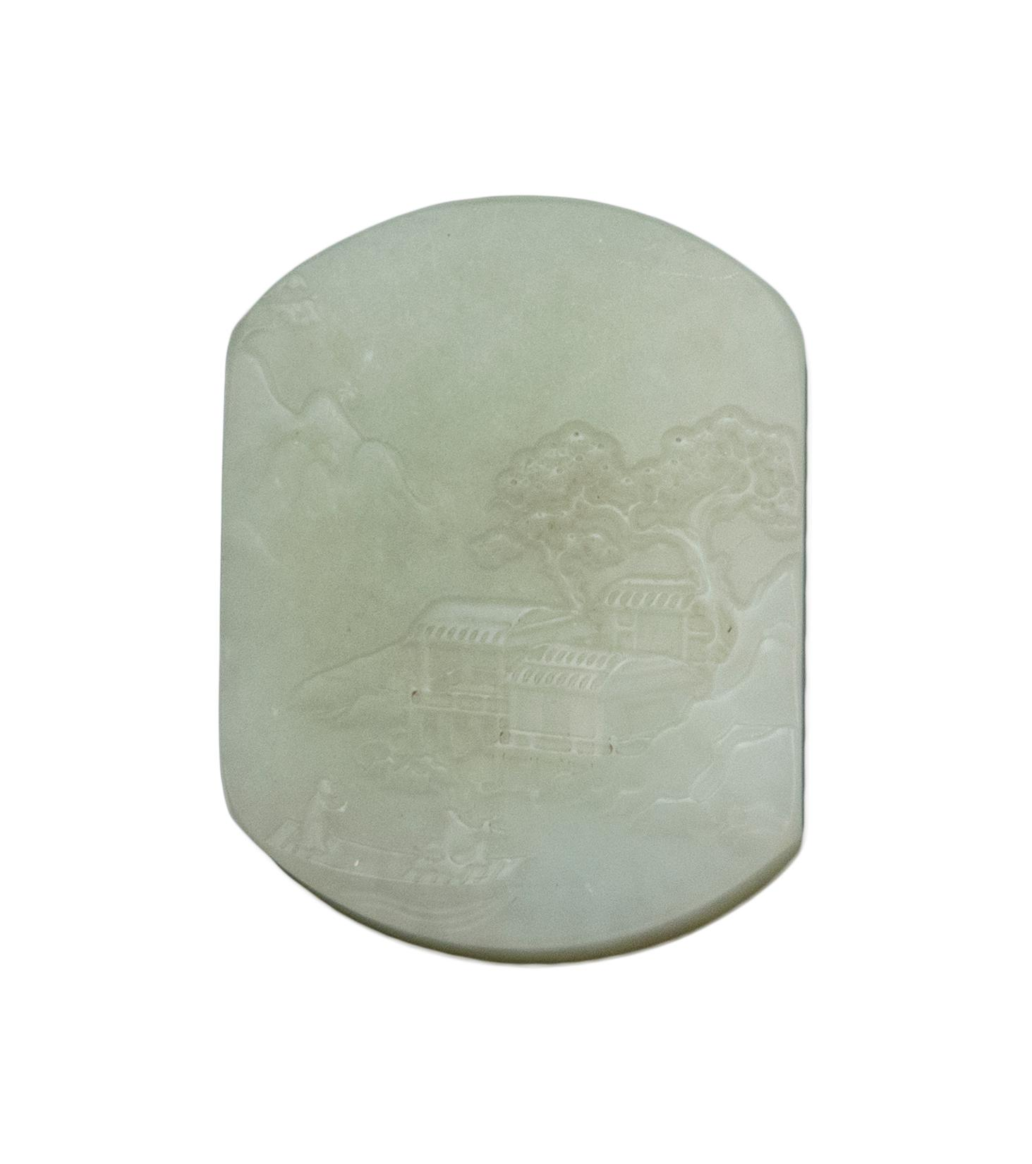 "CHINESE CELADON JADE PENDANT In modified rectangular form, depicting a river landscape featuring cottages and boatmen. Length 2.1""."