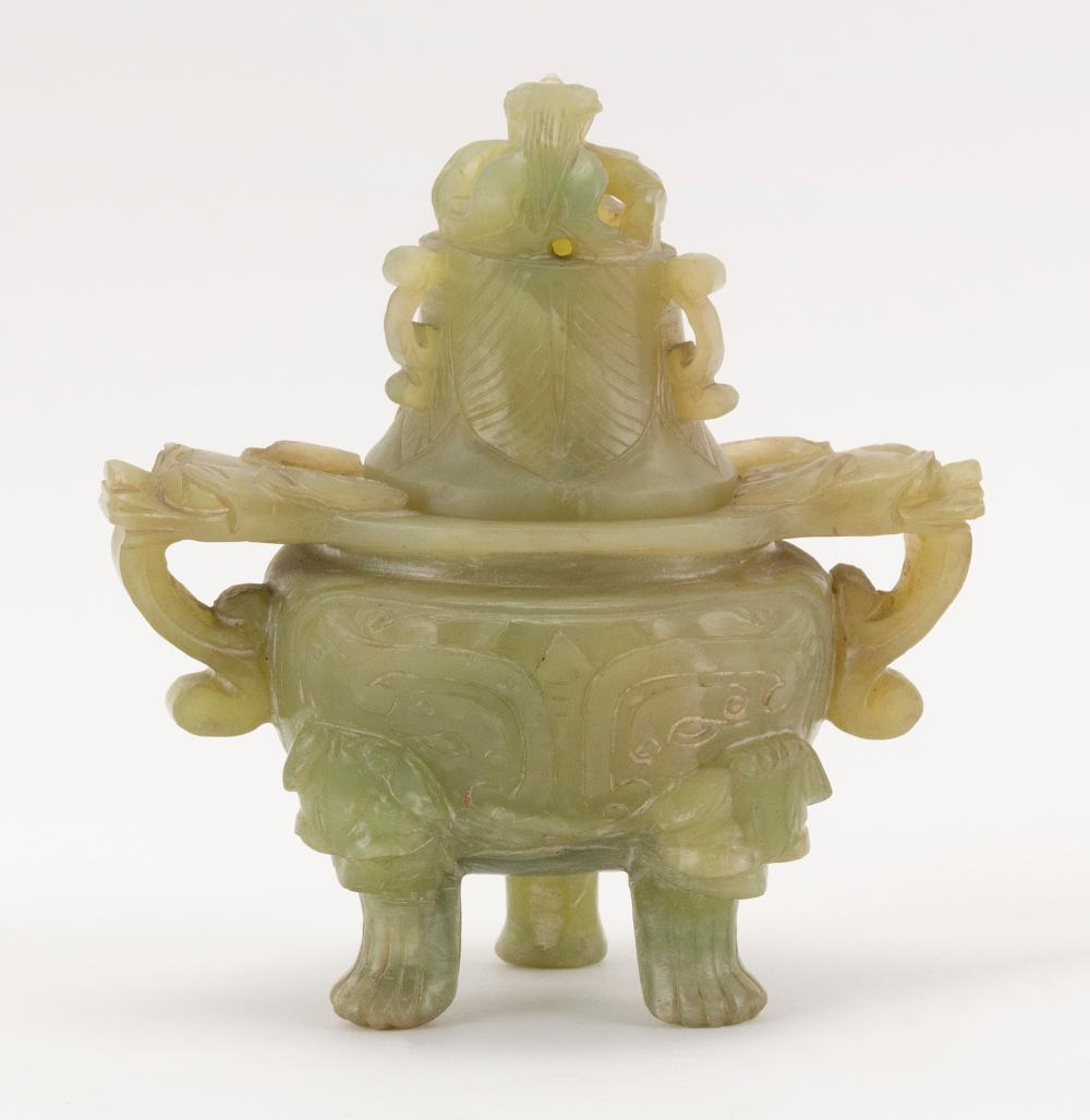 CHINESE GREEN JADE-LIKE HARDSTONE COVERED KORO Carved body with two mask-head handles and three mask-head feet. Cover with openwork-...