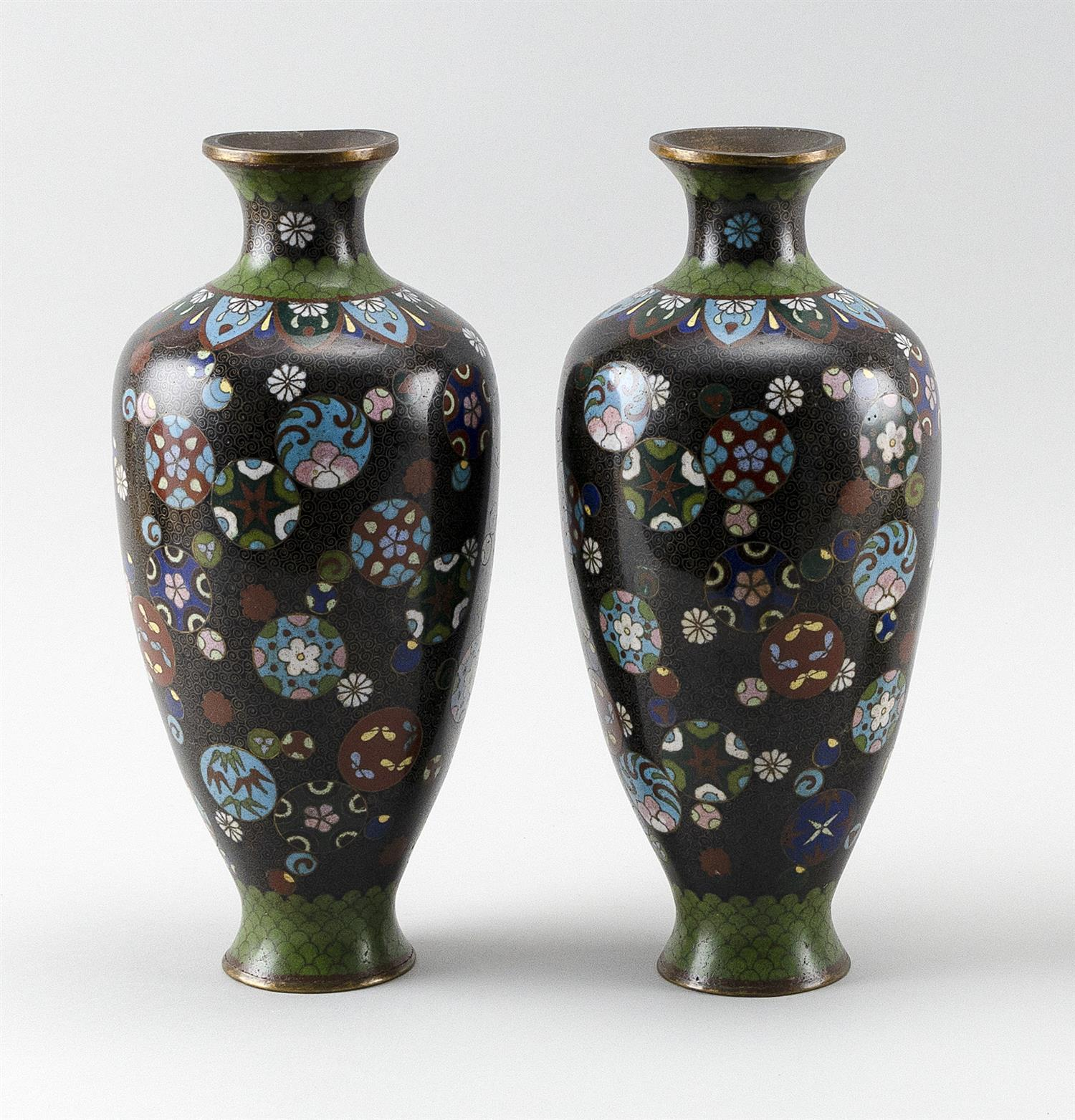 """PAIR OF JAPANESE CLOISONNÉ ENAMEL VASES In rouleau form, with decoration of a floral mon on a black ground. Height 10""""."""
